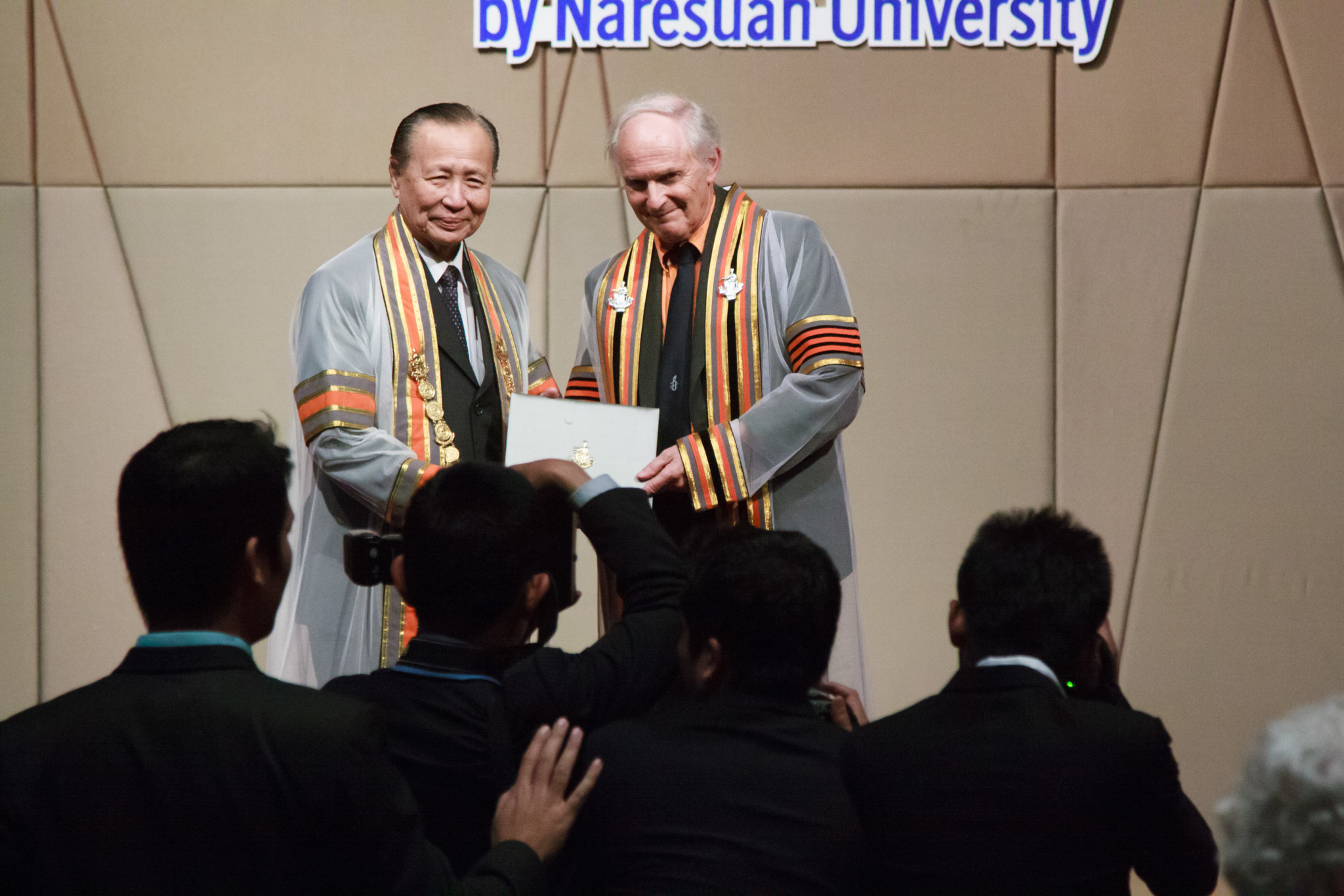 Chemistry Nobel Laureate Prof. Sir Harold W. Kroto being conferred an honorary doctorate degree by Naresuan University in Bangkok